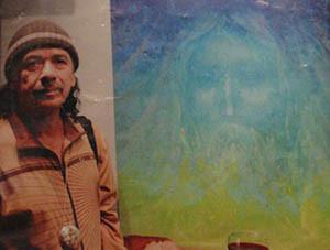 """Carlos Santana next to """"In His Image"""""""